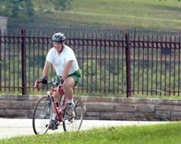Jack [John] Yates of Charles Village is shown in this 2004 photo taking advantage of a sunny day to cycle in Druid Hill Park. Baltimore Sun photo by Elizabeth Malby / June 21, 2004
